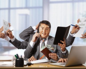businessman with eight hands