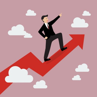 Businessman standing on a growing graph. Business Growth Concept